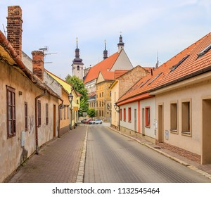 TRNAVA, SLOVAKIA - JULY 3, 2018: Old town street with St. John the Baptist Cathedral in the background. Old houses of Trnava in summer day. Historical center of Trnava. Ancient street in old city.