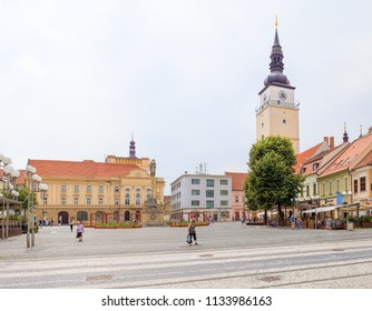 TRNAVA, SLOVAKIA - JULY 3, 2018: Trojicne namestie (Trinity square) with City Theater in background. Old Town Square in Trnava. Frequent place. Most known piazzas in city centre. Pedestrian zone.