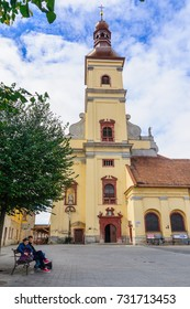 TRNAVA, SLOVAKIA - SEPTEMBER 24, 2013: View of St. John the Baptist Cathedral, with locals and visitors, In Trnava, Slovakia
