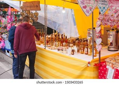 "TRNAVA, SLOVAKIA - SEPTEMBER 6, 2019: Market called: ""Tradicny Trnavsky Jarmok"". Stall with ""Medovina"", traditional slovak alcohol drink. In various bottles."