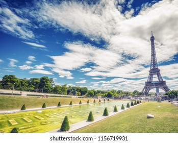 Trocadero Fountains and Eiffel tower on a summer day with dramatic clouds. Travel background.