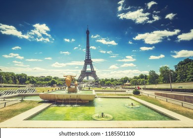 Trocadero Fountains and the Eiffel tower on a summer day with dramatic sky. Travel background.