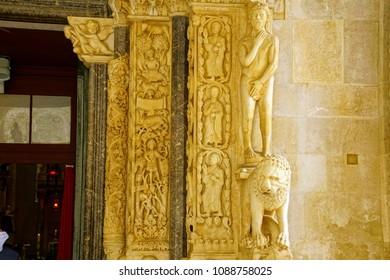 TROGIR, CROATIA - APR 15, 2018 -Statue of Adam after the Garden of Eden on the door of St Lawrence Cathedral, Trogir, Croatia