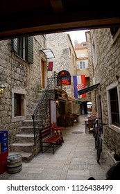 TROGIR, CROATIA - APR 15, 2018 -Narrow medieval street of Trogir, Croatia