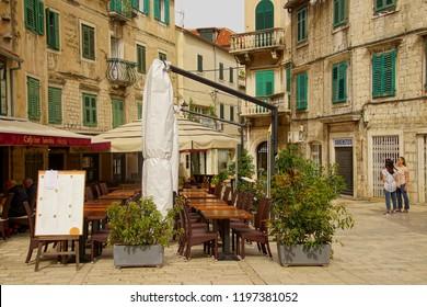 TROGIR, CROATIA - APR 15, 2018 - Small restaurant in the old city of Trogir, Croatia