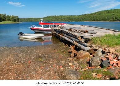Troitsk pier near the Holy Trinity Anzersky skete of the Solovki monastery on the Anzersky island, the Solovki islands, Arkhangelsk region, Russia
