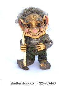 Troll with cane figurine on a white background