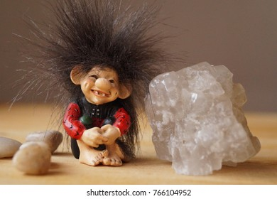 A troll cute with a salt crystal and stones