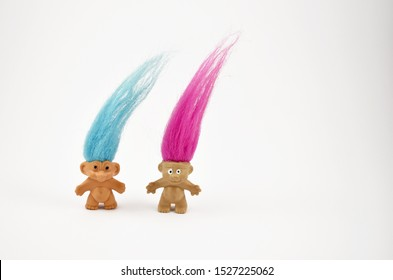 Troll figure stock images. Elf on a white background. Hairy troll. Troll girl and boy figure. Troll toy images. Two trolls isolated on a white background. Couple of trolls