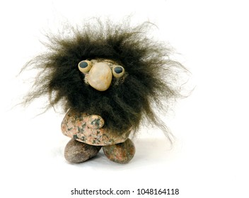 Troll made of boulders. troll is also used for someone who is very pleased to cause disagreement on the internet.