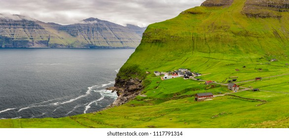 Trollanes Village and Beautiful Waterfall, Kalsoy, Faroe Islands, Denmark. Nordic Islands
