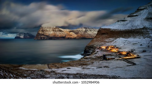 Trollanes village on Kalsoy island with Vidoy and Kunoy islands in the night, Faroe Islands