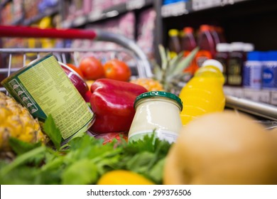 A trolley with healthy food at supermarket
