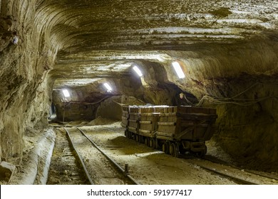Trolley in the mine tunnel with rails