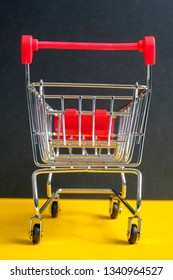 "A trolley on a black background. Symbol ""Black Friday"". Vertical."