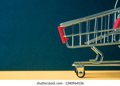 """A trolley on a black background. Symbol """"Black Friday"""". Toned."""