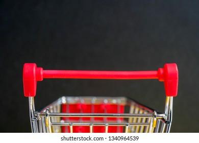 """A trolley on a black background. Symbol """"Black Friday""""."""