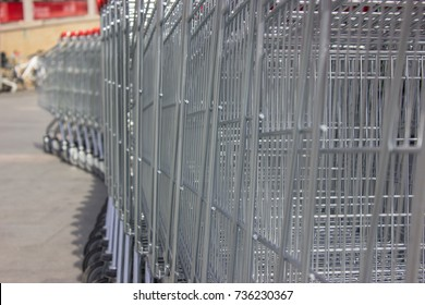 trolleys in the supermarket for products stand in a row of chrome silver color