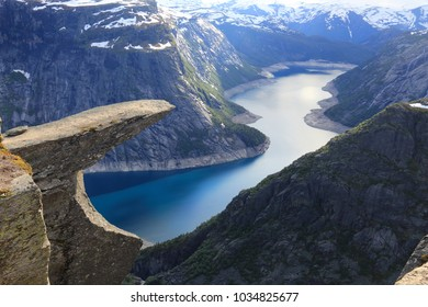 Troll's Tongue in Norway. Tourist attraction known as Trolltunga. Rock pulpit over lake.
