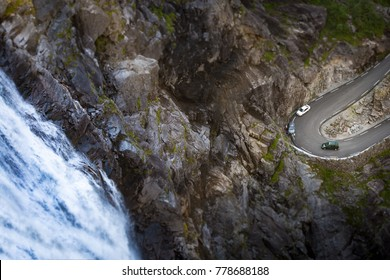 Trollstigen mountain road. Bridge over river with waterfall. Cars on serpentine. Auto travel in Norway, Europe, Scandinavia