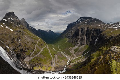 Trollstigen road. The panorama of world famous curvy road of Trollstigen with abrupt turns with a cloudy sunny sky on the background. Engineering marvel in Norway