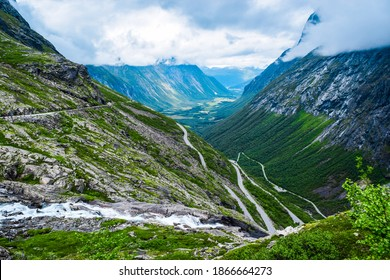 Trollstigen or Troll Stairs is a serpentine mountain road that is popular tourist attraction due to its steep incline of 10% and eleven hairpin bends up a steep mountainside, Andalsnes, Norway.