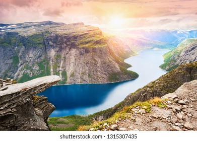 Trolltunga - famous landmark in Norway. Panoramic view of fjord lake and mountains, summer landscape