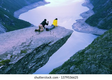 TROLLTUNGA, NORWAY - JULY 16, 2015: People visit Troll's Tongue (Trolltunga) rock in Hordaland county, Norway. The 22km trail to Trolltunga is among most visited in Norway.