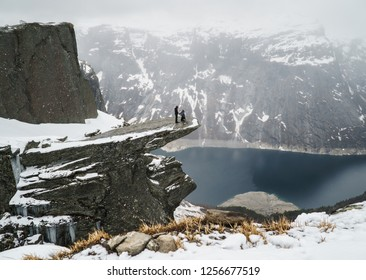 Trolltunga, Norway - May 04 2018: Couple in love on Troll Tongue during marriage proposal , Trolltunga May 04, 2018.