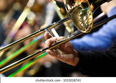 Trombone in the hands of a musician in a closeup orchestra