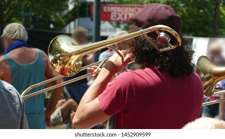 Trombone player entertains the crowd at the Waterfront Blues Festival, Portland, Oregon