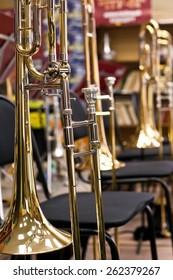 Trombones standing on stands