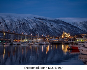 Tromso, Norway - Apr 17th, 2019: Arctic Cathedral at Night view of marina area in Tromso.