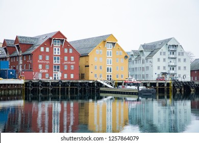 TROMSO, Norway - April 02, 2015: Harbor and waterfront with old buildings in the center of Tromso, northern Norway in spring. Rescue boat.