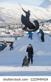 TROMSO NORWAY: Tromso is a city and municipality in Troms county, Norway on April 2016 Children playing o sculpture