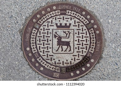 Tromso, Norway - June 01, 2018: Close-up of a gully cover in the city of Tromso
