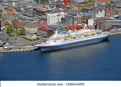 Tromso, Norway: -June 13th2019-Fred Olsen Cruise ship Black Watch alongside in Tromso, Norway with city in the background