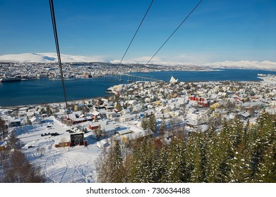 TROMSO, NORWAY - MARCH 29, 2011: View to the Tromso city from the Fjellheisen aerial tramway cabin in Tromso, Norway.