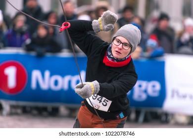 Tromso, Norway-February 10, 2018: national holiday-reindeer herder's Day in Tromso, Norway-February 10, 2018. Sporting activity. reindeer herders throws lasso.