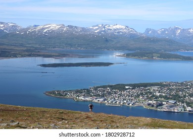 TROMSO, TROMS OG FINNMARK COUNTY / NORWAY - AUGUST 08 2020: Tromso city view from Storsteinen hill. Panorama of the city of Tromso. View on the mountains and Norwegian fjords
