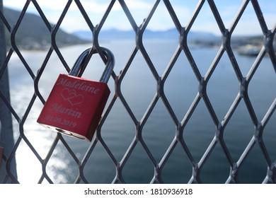 TROMSO, TROMS OG FINNMARK COUNTY / NORWAY - AUGUST 08 2020: A love lock or love padlock at Tromso bridge