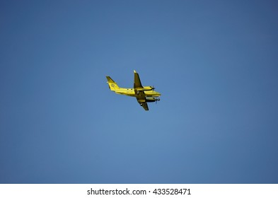 TROMSOE, NORWAY - SEPTEMBER 27, 2013: yellow Beech King Air B200 ambulance airplane operated by Lufttransport AS landing on Langnes Airport.