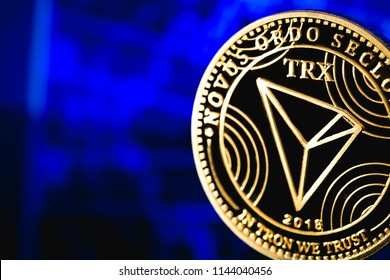 tron coin cryptocurrency on the blue background