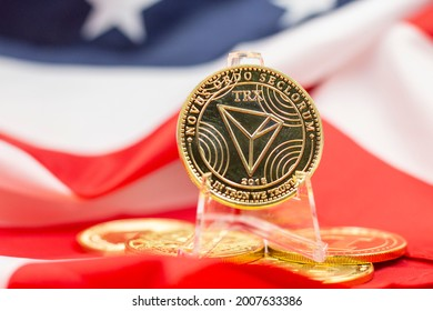 TRON coin is on flag of America, TRON is a Blockchain with a cryptocurrency native to the system, known as TRX. Justin Sun founded the cryptocurrency in 2017.