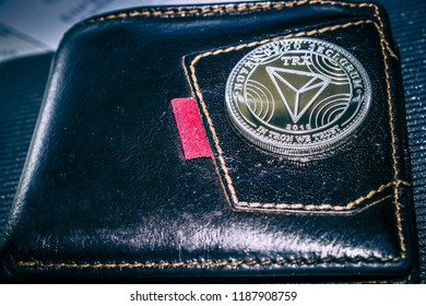 the tron cryptocurrency coin on leather wallet.