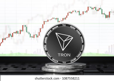 TRON (TRX) cryptocurrency; physical concept tron (tronix) coin on the background of the chart