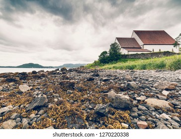 TRONDENES, NORWAY - JULY 9, 2018: Trondenes Church outside Harstad town. Northernmost medieval stone church in Norway and world's northernmost medieval building.
