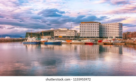 Trondheim, Norway 04/26/2018 : Hotel Clarion, Pirbadet and marina Brattoera in the Norwegian city Trondheim during colorful sunset