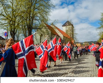 Trondheim, Norway - 05/17/2016: Celebration of May 17th - the National Day of Norway in the city of Trondheim - inhabitants marching through the streets wearing traditional clothes