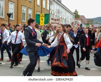 Trondheim, Norway - 05/17/2016: Celebration of May 17th - the National Day of Norway in the city of Trondheim - inhabitants marching and dancing on the streets wearing traditional clothes